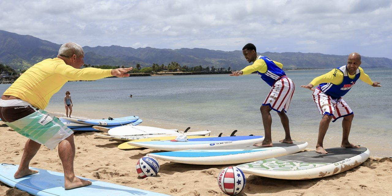 Harlem Globetrotters Dribble While Surfing Hawaii's North Shore